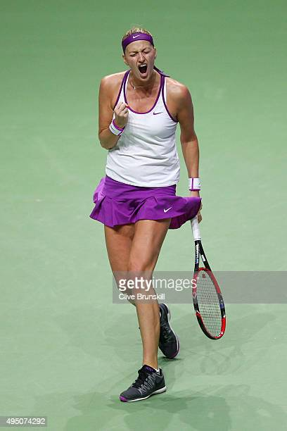 Petra Kvitova of Czech Republic reacts to a point against Maria Sharapova of Russia in the semi-final match of the BNP Paribas WTA Finals at...