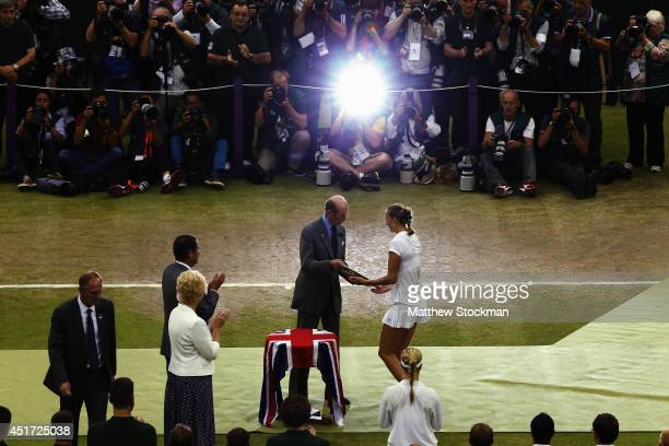 Petra Kvitova of Czech Republic receives the Venus Rosewater Dish trophy from Prince Edward Duke of Kent after her victory in the Ladies' Singles...
