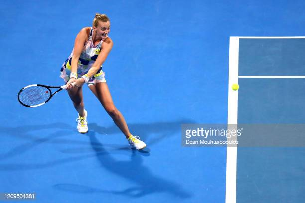 Petra Kvitova of Czech Republic returns a backhand against Aryna Sabalenka of Belarus in their Singles Final match on Day 7 of the WTA Qatar Total...