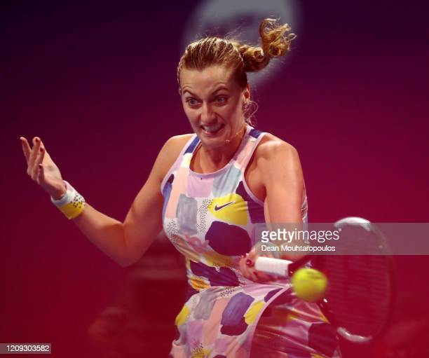 Petra Kvitova of Czech Republic returns a forehand against Ashleigh Barty of Australia in their semi final match during Day 6 of the WTA Qatar Total...
