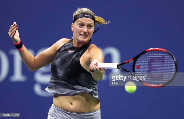 Petra Kvitova of Czech Republic returns a shot against Venus Williams of the United States during her Women's Singles Quarterfinal Match on Day Nine...