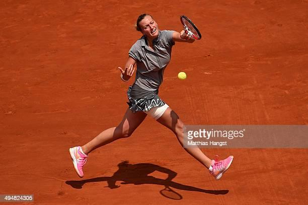 Petra Kvitova of Czech Republic returns a shot during her women's singles match against Svetlana Kuznetsova of Russia on day seven of the French Open...