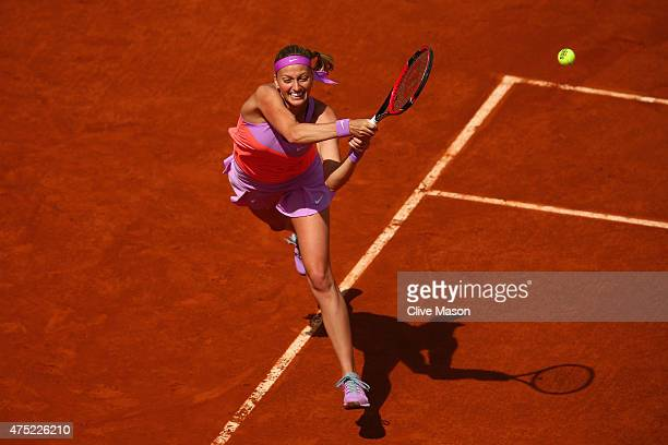 Petra Kvitova of Czech Republic returns a shot in her Women's Singles match against IrinaCamelia Begu of Romania on day seven of the 2015 French Open...