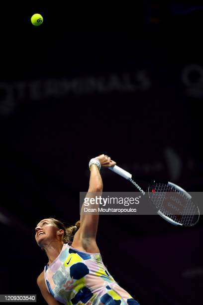 Petra Kvitova of Czech Republic serves against Ashleigh Barty of Australia in their semi final match during Day 6 of the WTA Qatar Total Open 2020 at...