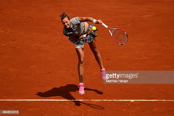 Petra Kvitova of Czech Republic serves during her women's singles match against Svetlana Kuznetsova of Russia on day seven of the French Open at...