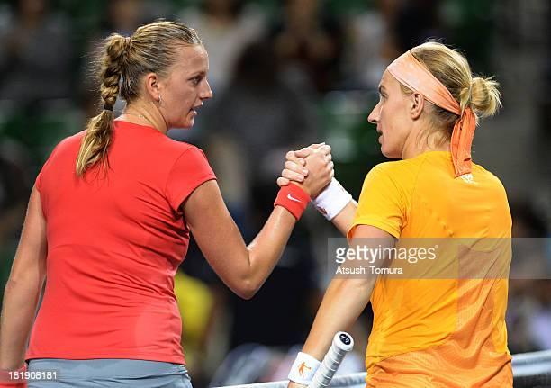 Petra Kvitova of Czech Republic shakes hands with Svetlana Kuznetsova of Russia after winning their women's singles quarter final match during day...