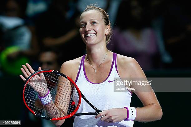Petra Kvitova of Czech Republic waves to the crowd after defeating Maria Sharapova of Russia in the semifinal match of the BNP Paribas WTA Finals at...