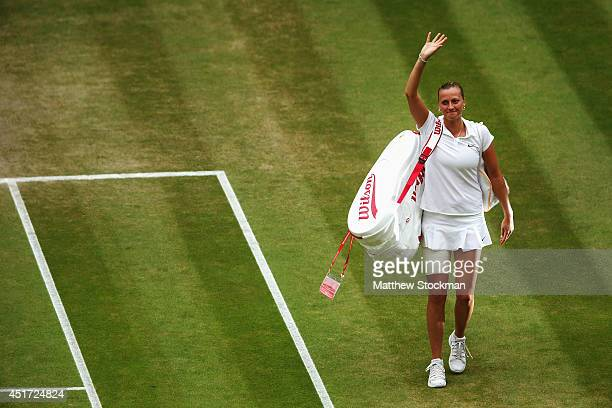 Petra Kvitova of Czech Republic waves to the fans as she walks of court after winning the Ladies' Singles final match against Eugenie Bouchard of...