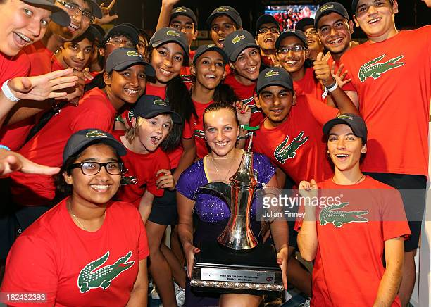 Petra Kvitova of Czech Republic with the trophy poses with ball boys and girls after defeating Sara Errani of Italy in the final during day six of...