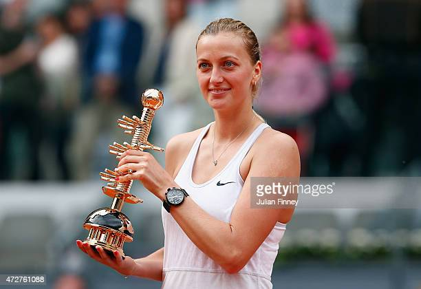 Petra Kvitova of Czech Republic with the winners trophy after defeating Svetlana Kuznetsova of Russia in the final during day eight of the Mutua...