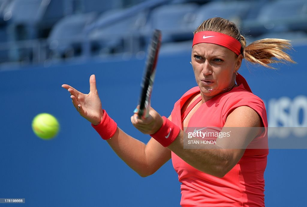 Petra Kvitova of the Czech Repbulic returns a shot to Misaki Doi of Japan during their 2013 US Open women's singles match at the USTA Billie Jean King National Tennis Center August 27, 2013 in New York. AFP PHOTO/Stan HONDA