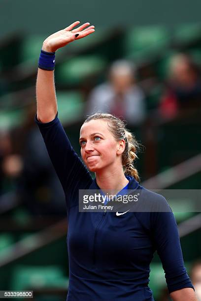 Petra Kvitova of the Czech Republic acknowledges the crowd following her victory during the Ladies Singles first round match against Danka Kovinic of...