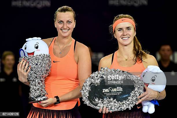 Petra Kvitova of the Czech Republic and Elina Svitolina of Ukraine pose with their trophies after their singles final match at the WTA Elite Trophy...