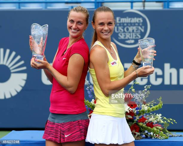Petra Kvitova of the Czech Republic and Magdalena Rybarikova of Slovakia pose with their trophies after the women's final of the Connecticut Open at...