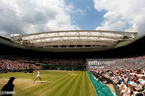 Petra Kvitova of the Czech Republic and Maria Sharapova of Russia in action during their Ladies' final round match on Day Twelve of the Wimbledon...