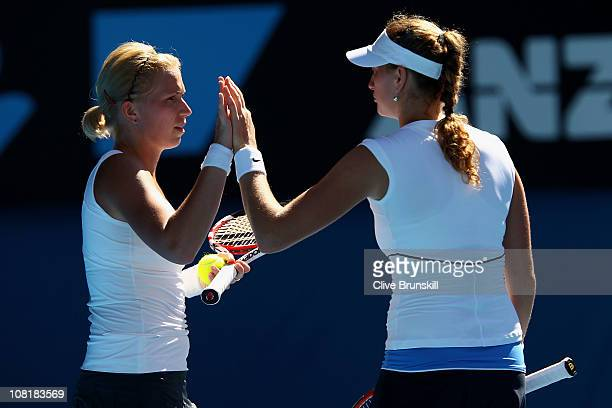 Petra Kvitova of the Czech Republic and Michaella Krajicek of the Netherlands celebrate winning a point in their first round doubles match against...