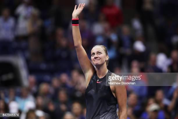 Petra Kvitova of the Czech Republic celebrates defeating Garbine Muguruza of Spain during their fourth round Women's Singles match between on Day...