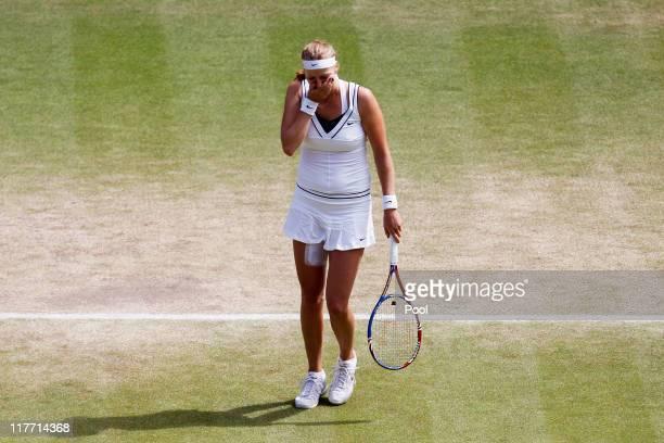 Petra Kvitova of the Czech Republic celebrates match point after winning her Women's semifinal match against Victoria Azarenka of Belarus on Day Ten...