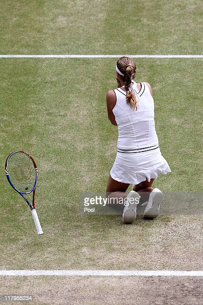 Petra Kvitova of the Czech Republic celebrates match point after winning her Ladies' final round match against Maria Sharapova of Russia on Day...