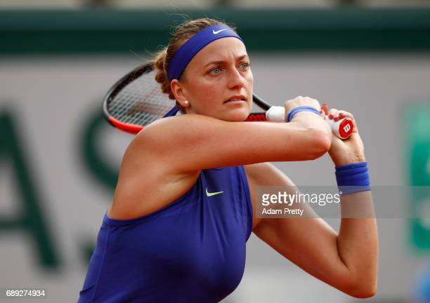 Petra Kvitova of the Czech Republic hits a backhand during the ladies singles first round match against Julia Boserup of the United States on day one...