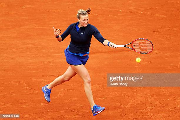 Petra Kvitova of the Czech Republic hits a forehand during the Ladies Singles first round match against Danka Kovinic of Montenegro on day one of the...