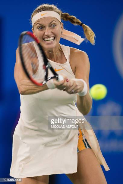 Petra Kvitova of the Czech Republic hits a return against Anastasia Pavlyuchenkova of Russia during their women's singles third round match of the...