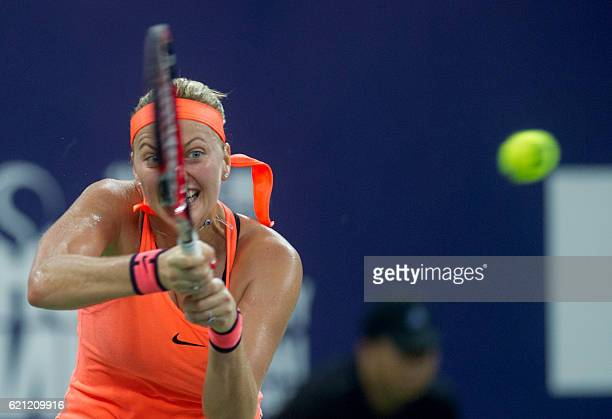 Petra Kvitova of the Czech Republic hits a return against Zhang Shuai of China during their women's singles semifinal match at the WTA Elite Trophy...