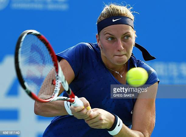 Petra Kvitova of the Czech Republic hits a return during her win over Eugenie Bouchard of Canada in the final of the Wuhan Open tennis tournament in...