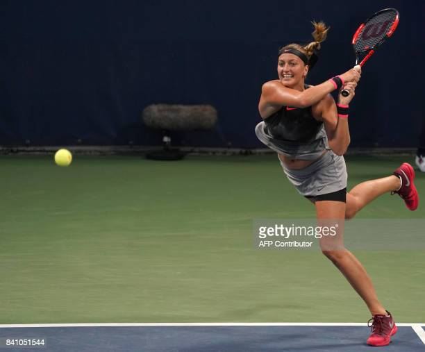 Petra Kvitova of the Czech Republic hits a return to Alize Cornet of France during their 2017 US Open Women's Singles match at the USTA Billie Jean...