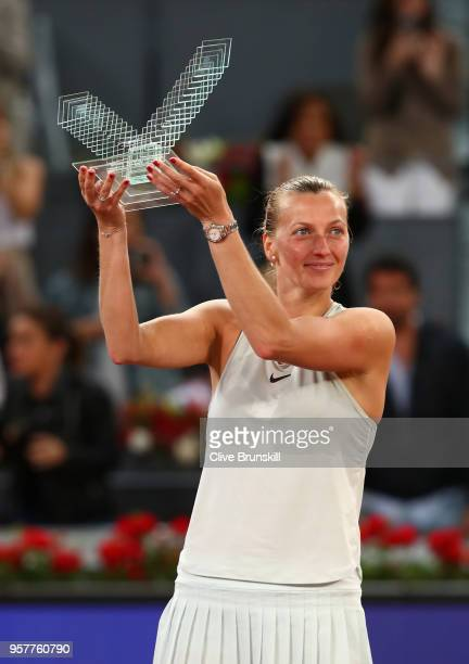 Petra Kvitova of the Czech Republic holds aloft her winners trophy after her three set victroy against Kiki Bertens of the Netherlands in the womens...