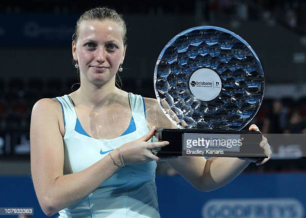 Petra Kvitova of the Czech Republic holds the winners trophy as she celebrates victory after her finals match against Andrea Petkovic of Germany...