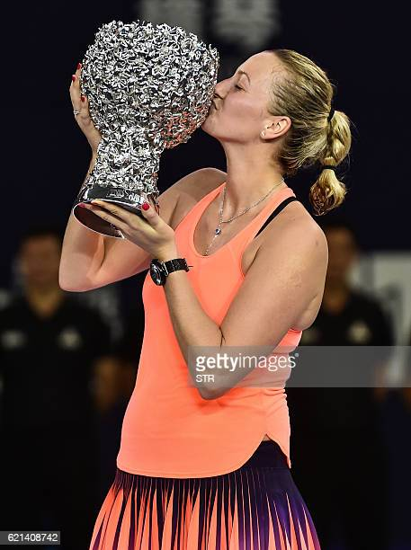 Petra Kvitova of the Czech Republic kisses her trophy after winning the singles final match against Elina Svitolina of Ukraine at the WTA Elite...