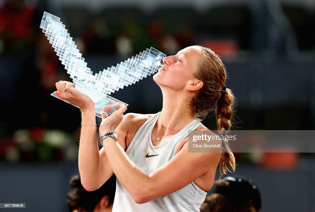 Petra Kvitova of the Czech Republic kisses her winners trophy after her three set victroy against Kiki Bertens of the Netherlands in the womens final during day eight of the Mutua Madrid Open tennis tournament at the Caja Magica on May 12, 2018 in Madrid, Spain.