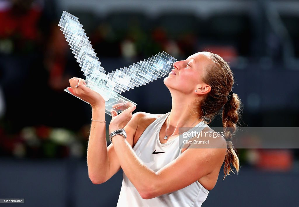 Petra Kvitova of the Czech Republic kisses her winners trophy after her three set victory against Kiki Bertens of the Netherlands in the womens final during day eight of the Mutua Madrid Open tennis tournament at the Caja Magica on May 12, 2018 in Madrid, Spain.