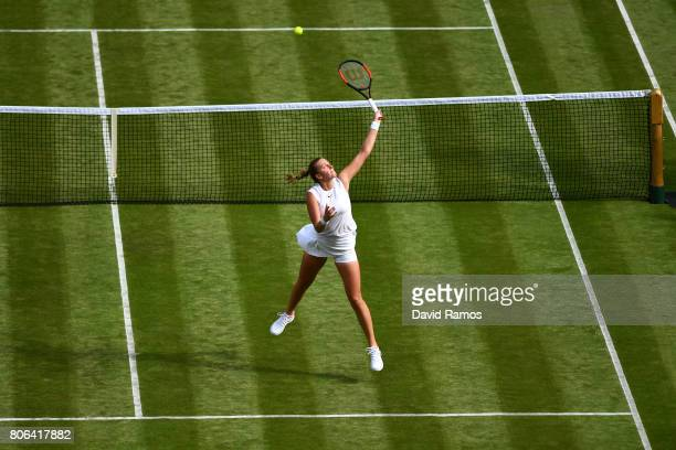 Petra Kvitova of The Czech Republic leaps to volley the ball during the Ladies Singles first round match on day one of the Wimbledon Lawn Tennis...