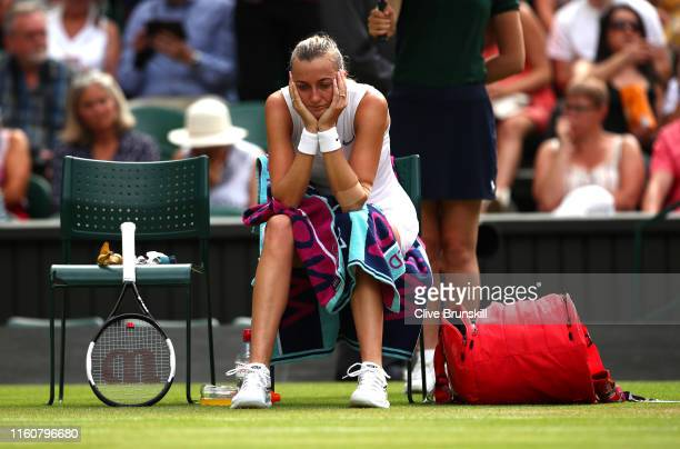Petra Kvitova of The Czech Republic looks dejected during a change of serve in her Ladies' Singles fourth round match against Johanna Konta of Great...