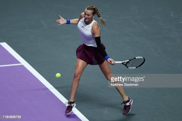 Petra Kvitova of the Czech Republic plays a forehand against Ashleigh Barty of Australia during their Women's Singles match on Day Five of the 2019...