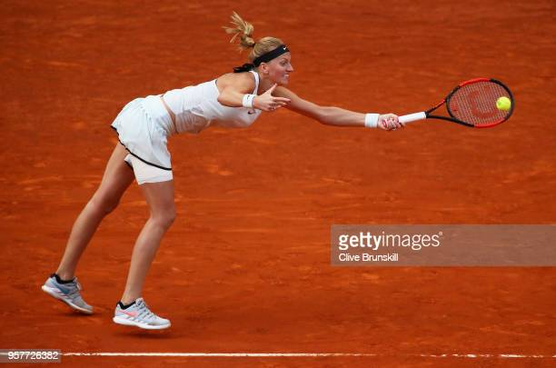 Petra Kvitova of the Czech Republic plays a forehand against Kki Bertens of the Netherlands in the womens final during day eight of the Mutua Madrid...