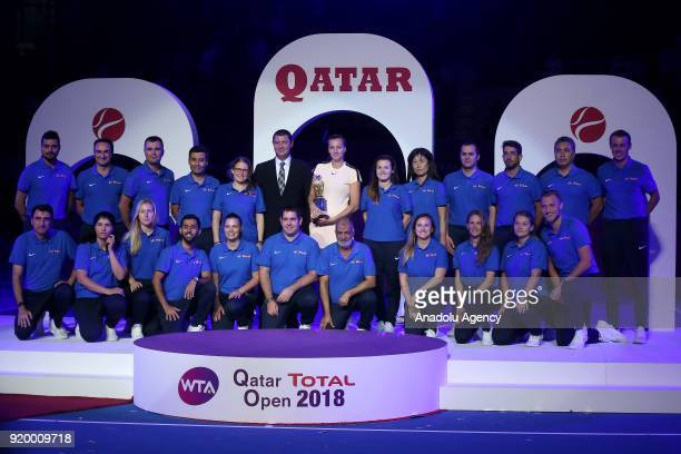 Petra Kvitova of the Czech Republic poses for a photo sporters after defeating Garbine Muguruza of Spain during the final match of the women's...
