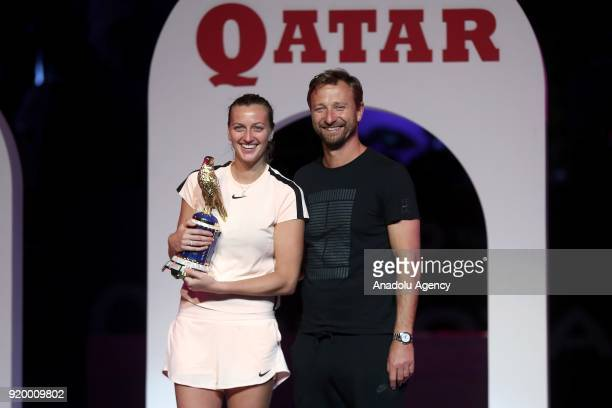 Petra Kvitova of the Czech Republic poses for a photo with her coach Jiri Vanek after defeating Garbine Muguruza of Spain during the final match of...