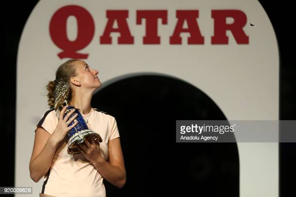 Petra Kvitova of the Czech Republic poses for a photo with her trophy after defeating Garbine Muguruza of Spain during the final match of the women's...