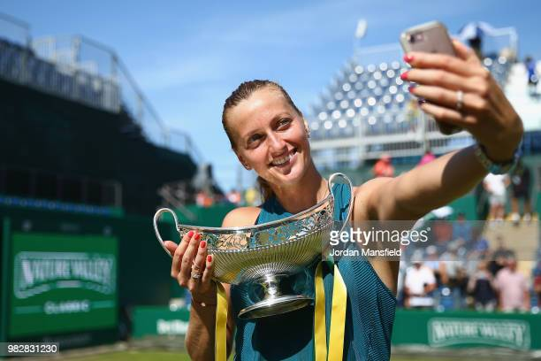 Petra Kvitova of the Czech Republic poses for a selfie with the Trophy after her singles Final match against Magdalena Rybarikova of Slovakia during...