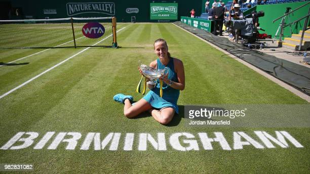 Petra Kvitova of the Czech Republic poses with the Trophy after her singles Final match against Magdalena Rybarikova of Slovakia during day nine of...