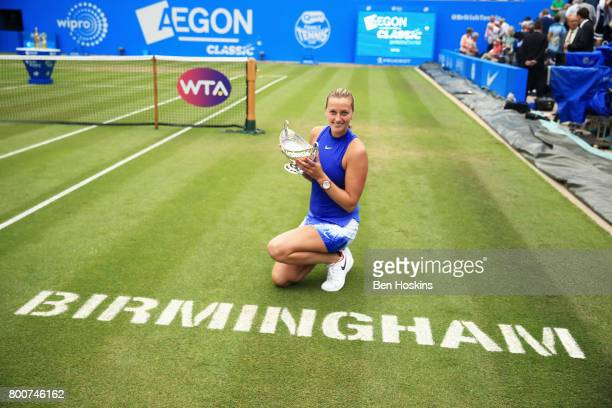 Petra Kvitova of the Czech Republic poses with the trophy after the Women's Singles final match against Ashleigh Barty on day seven of the Aegon...