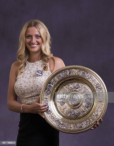 Petra Kvitova of the Czech Republic poses with the Venus Rosewater Dish trophy at the Wimbledon Championships 2014 Winners Ball at The Royal Opera...