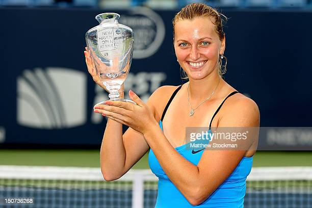 Petra Kvitova of the Czech Republic poses with the winner's trophy after defeating Maria Kirilenko of Russia during the final of the New Haven Open...