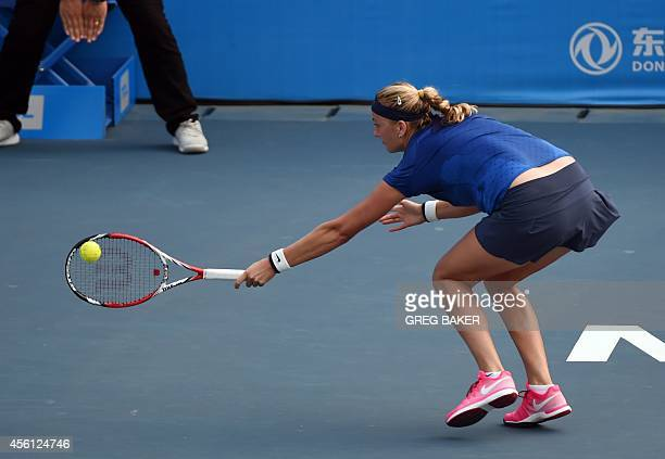 Petra Kvitova of the Czech Republic reaches for a return during her semifinal win over Elina Svitolina of Ukraine at the Wuhan Open tennis tournament...