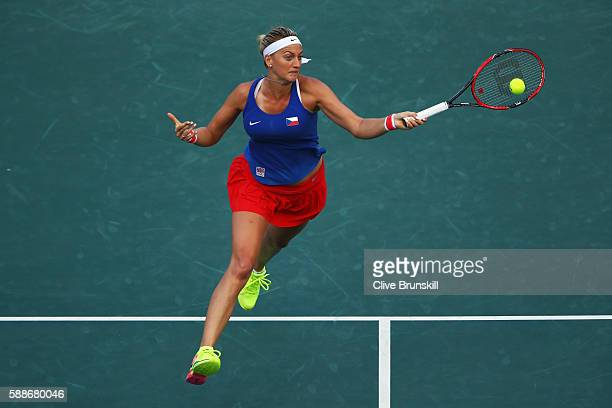 Petra Kvitova of the Czech Republic returns a forehand against Monica Puig of Puerto Rico during the Women's Singles Semifinal on Day 7 of the Rio...