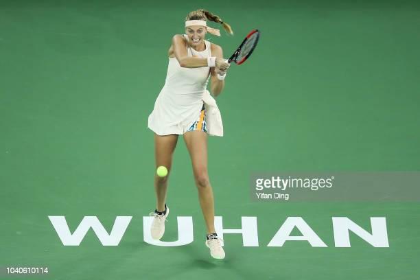 Petra Kvitova of the Czech Republic returns a shot against Anastasia Pavlyuchenkova of Russia during their women's singles third round match of the...