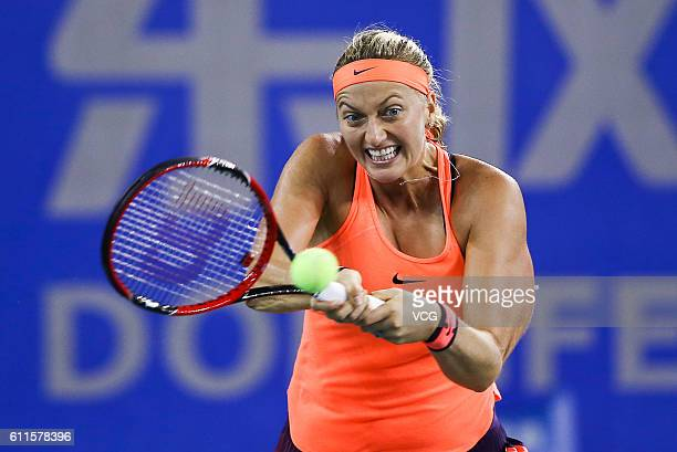 Petra Kvitova of the Czech Republic returns a shot during the women's singles semifinal match against Simona Halep of Romania on day six of the 2016...